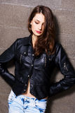 Pretty young woman in a leather black jacket Stock Photography