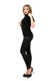 Pretty young woman in leggings. Isolated on white Royalty Free Stock Photos