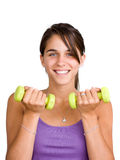 Pretty young woman lifting dumbbells Royalty Free Stock Photos