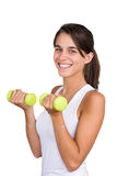 Pretty young woman lifting dumbbells Royalty Free Stock Image