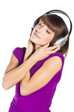Pretty young woman listening music Stock Photography
