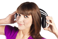 Pretty young woman listening music Stock Photos