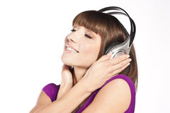 Pretty young woman listening music Royalty Free Stock Photography