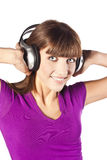 Pretty young woman listening music Stock Photo