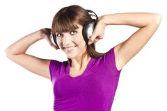 Pretty young woman listening music Stock Image
