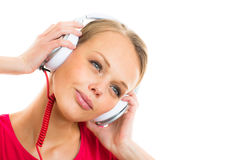 Pretty, young woman listening to her favorite music Stock Photo
