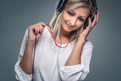 Pretty, young woman listening to her favorite music Royalty Free Stock Photos