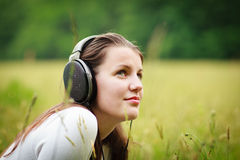 pretty young woman listening to music Stock Images