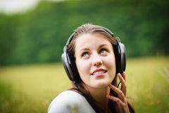 Pretty young woman listening to music Royalty Free Stock Photo