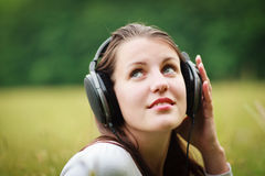 Pretty young woman listening to music Stock Image