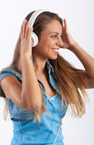 Pretty young woman listening to music Royalty Free Stock Photography