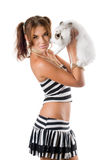 Pretty young woman with little rabbit Stock Images