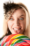 Pretty young woman with lollipop Stock Image