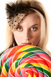 Pretty young woman with lollipop Royalty Free Stock Images