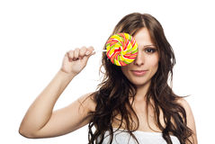 Pretty young woman with lollipop candy Royalty Free Stock Photo