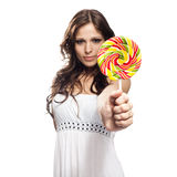 Pretty young woman with lollipop candy Royalty Free Stock Images