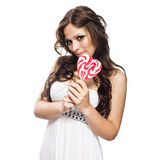 Pretty young woman with lollipop candy Royalty Free Stock Photos