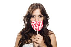 Pretty young woman with lollipop candy Stock Photo