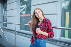 Happy young women posing on camera outdoors. royalty free stock images