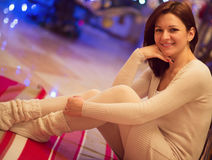 Pretty young woman looking with attractive smile - indoors Royalty Free Stock Photo