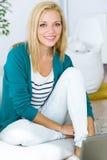 Pretty young woman looking at camera at home. Royalty Free Stock Photography