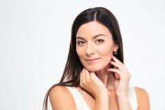 Pretty young woman looking at camera Stock Image