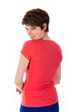 Pretty young woman looking over her shoulder royalty free stock photos