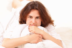 Pretty young woman lying in bed Royalty Free Stock Photography