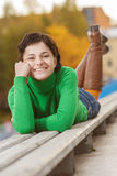 Pretty young woman lying on bench Royalty Free Stock Photo