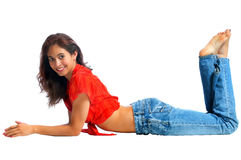 Pretty young woman lying on the floor Stock Image