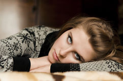 A pretty young woman lying on her arms Stock Images