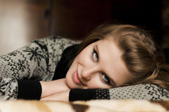 A pretty young woman lying on her arms Stock Image