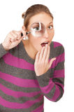 Pretty young woman with magnifier Stock Photo