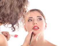 Pretty young woman is make up Stock Photography