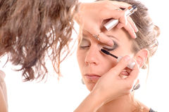 Pretty young woman is make up Stock Photos
