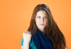 Pretty young woman making a fist Stock Images