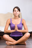 Pretty young woman meditating Royalty Free Stock Photography