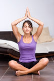 Pretty young woman meditating Stock Photos