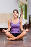 Pretty young woman meditating Stock Images
