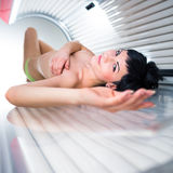 Pretty young woman  in a modern solarium Royalty Free Stock Photo