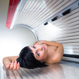 Pretty young woman  in a modern solarium Royalty Free Stock Photos