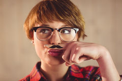 Pretty young woman with mustache on finger Stock Photos