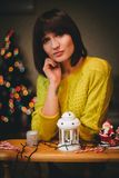 Pretty young woman near christmas tree in her cozy room Stock Photo