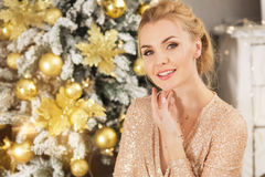 Pretty young woman near Christmas tree at home. Pretty young woman near Christmas tree Stock Photo