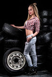 Pretty young woman near the wheels Royalty Free Stock Photography