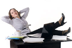 Pretty young woman in an office Stock Photos