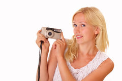 Pretty young woman with an old camera Stock Image