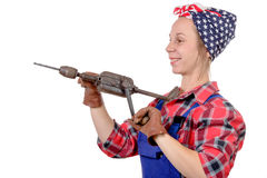 Pretty young woman with a old drill Stock Photography