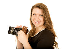 Pretty young woman with an old school camera smiling Stock Photography