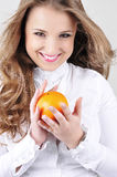 Pretty young woman with orange. Royalty Free Stock Photo